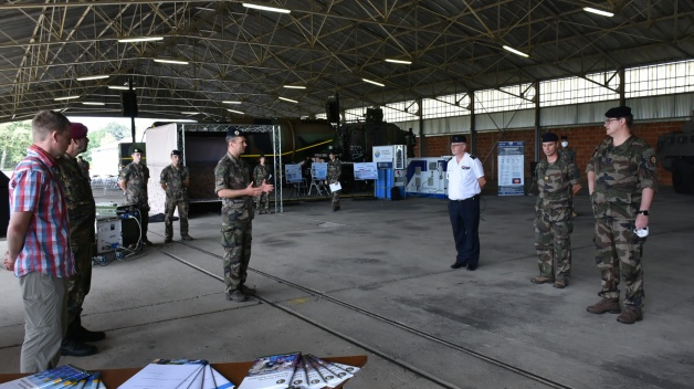 NATO ENSEC COE delegation presented the Centre in the exhibition organised by the Joint Fuel...
